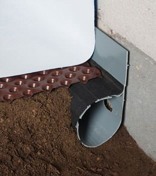 Closeup of a crawl space drainage system installed in Coppell