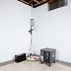Sump pump system, dehumidifier, and basement wall panels installed during a sump pump installation in North Richland Hills
